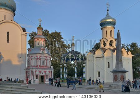 Sergiev Posad, Russia - August 29 2015: a Lot of pilgrims and tourists in the main square at the Cathedral of the Holy Trinity St. Sergius Lavra. Sergiyev Posad is included into the Golden ring of Russia and is a pilgrimage center of the Christian world.