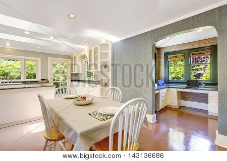 Dining Area With Table Set In White Tones And Tile Floor