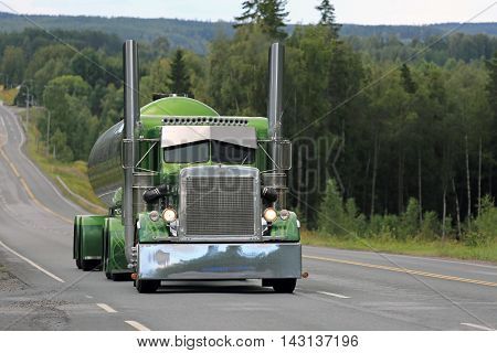 IKAALINEN, FINLAND - AUGUST 11, 2016: Peterbilt 359 year 1971 of Fredrik Biehl moves along scenic highway on the way to the annual trucking event Power Truck Show 2016 in Alaharma Finland.