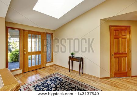 Nice Bright Entry Way To Home With Hardwood Floor And Rug.