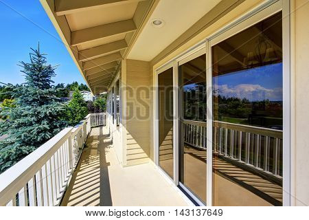 Balcony House Exterior With Wooden Railings And Perfect View.