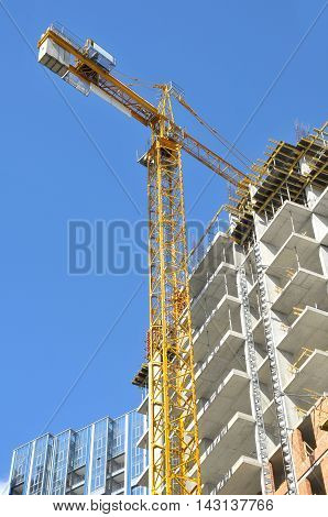 Construction work and building crane against the blue