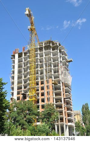 building of the new apartment house against the blue