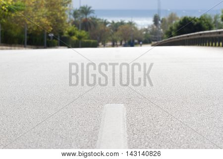Road texture. Travel road against landscape, sea and sky