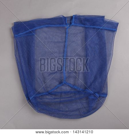 Harvest gear of nylon grass nets for fishing on grey background