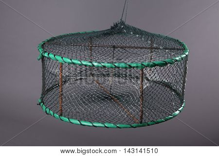 Harvest gear of fixed disk-type crab cages with three entrance on grey background