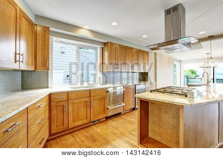 Kitchen Room With Wooden Cabinets, Granite Counter Top And Island.