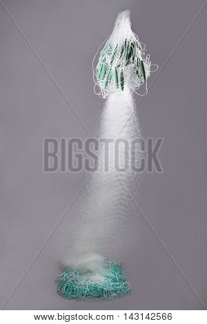 Harvest fishing tackle of heavy lead original subnet on grey background