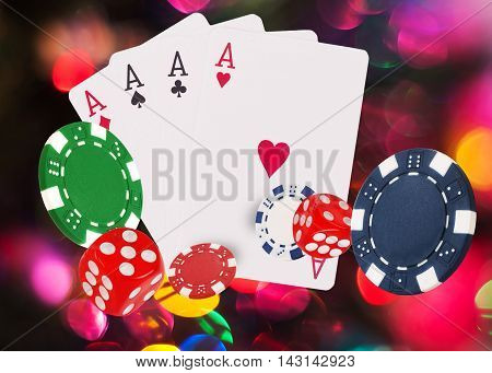 Playing cards and chips flying at bright background