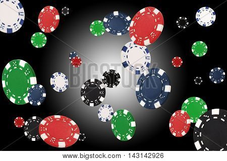 Playing chips flying at the white-black background
