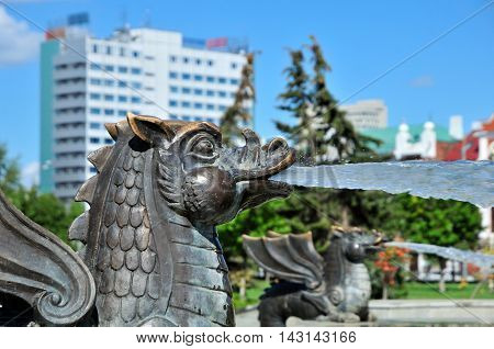 Kazan, Tatarstan, Russia - August 16, 2016. Fountain in Millennium Park, fragment. Zilant - in Tartar legends and tales of mythological creature with the face of the dragon or winged snake.