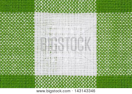 Green and white tablecloth texture background, close up