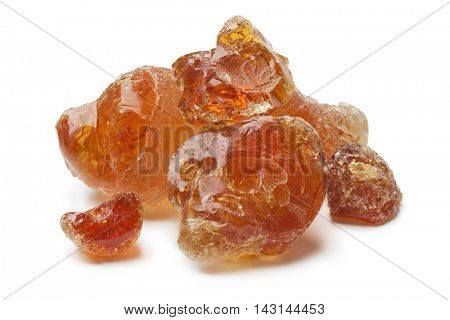 Pieces of Gum arabic on white background