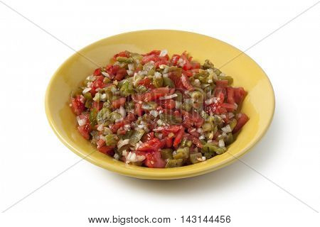 Traditional Moroccan dish with bell pepper salad on white background
