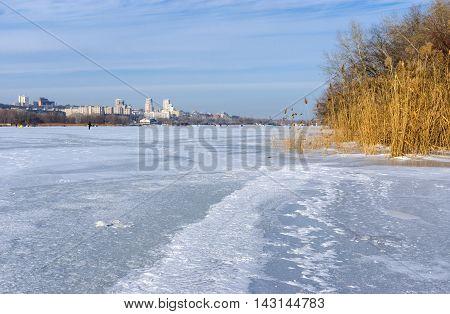 Ukranian winter landscape - view on Dnepropetrovsk city from frozen river Dnepr