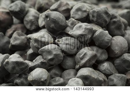 Dried black Ceci Neri chickpeas full frame close up