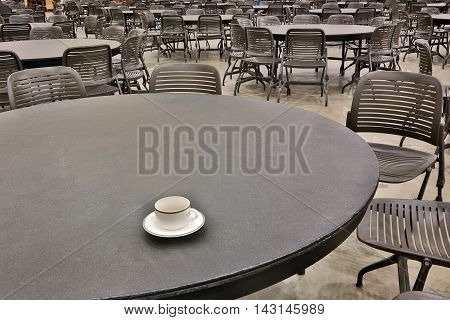 tables and chairs made of cast metal in a cafe. empty seats in the cafe.