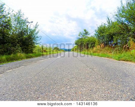 Asphalt road and nature during cloudy day