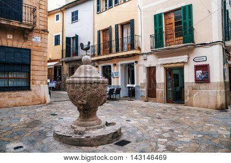 Pollensa Mallorca Spain - May 24 2015: Fountain on the Cock area or La Font del Gall in the center of Pollensa in Mallorca.