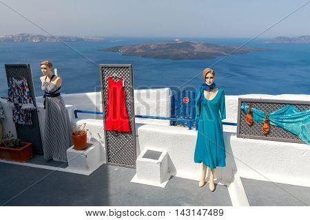 Fira, Greece - April 30, 2016: Street clothing boutique on the main street in the village Fira on Santorini Island. Many tourists shopping in mgazinah island.
