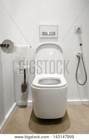 white bathroom with white toilet and bidet