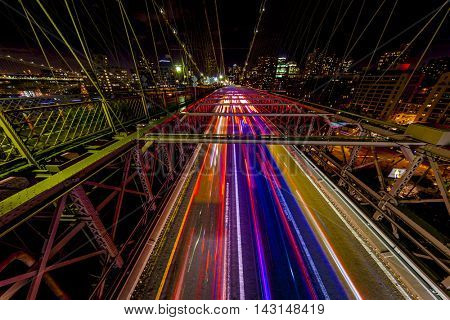 High color contrast traffic image of the Brooklyn Bridge in New York