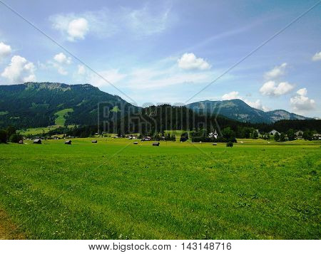 View Idyllic, beauty alpine landscape in Austria: mountains, forests, meadows and houses, Austria, Europe