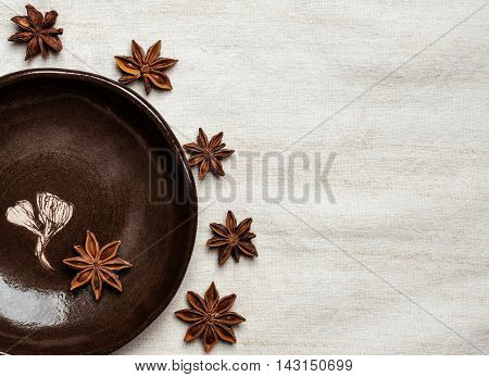 Clay pots and plate with anise-tree seeds