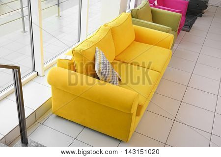 Modern yellow couch for sale in furniture store