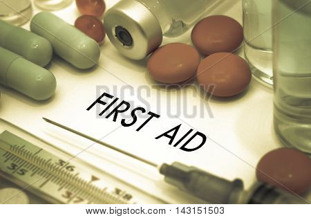 First aid. Treatment and prevention of disease. Syringe and vaccine. Medical concept. Selective focus