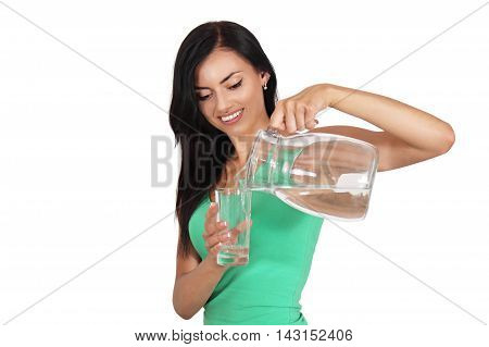 Beautiful woman holding a jug of water and a glass.woman pours water, Isolated on white