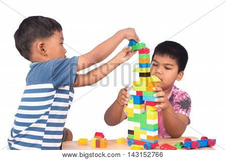 Two brother play building brickfocus little boy