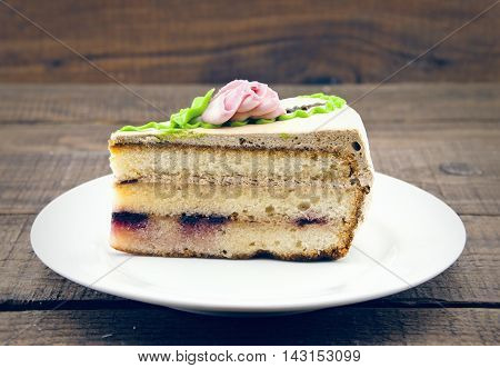 Layered Cake Slice On Wooden Dark Background