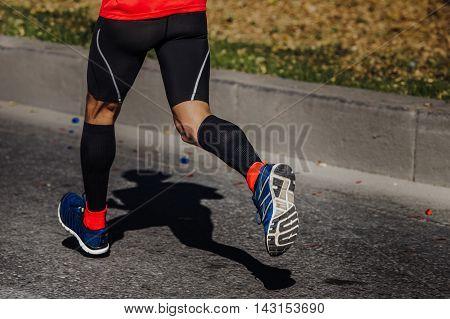 compression socks on feet of a man athlete running a marathon