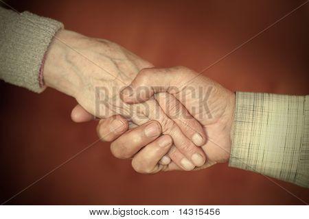 Handclasp Between Elderly People