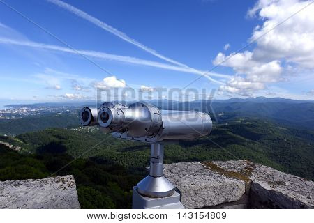 Sightseeing binoculars on the observation deck of the tower of Akhun