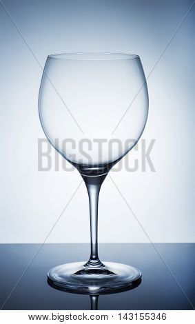 An empty wine glass on a white background
