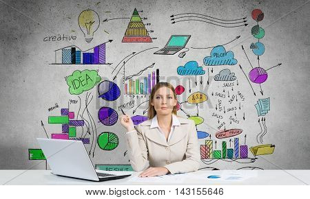 Young businesswoman with pen in hands thinking over her business plan