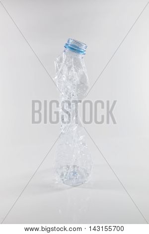 plastic bottles that can be recycled. Bottles of water being squeezed