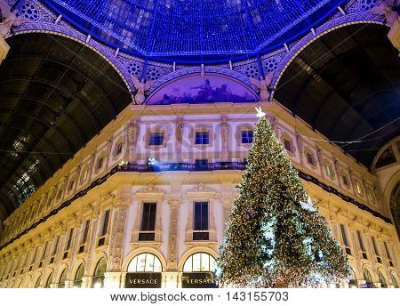 ITALY, MILAN, DESEMBER, 23, 2015 - Bottom view on the glass dome during Christmas in shopping mall the Galleria Vittorio Emanuele II, named after the first king of the Kingdom of Italy. Milan, Italy