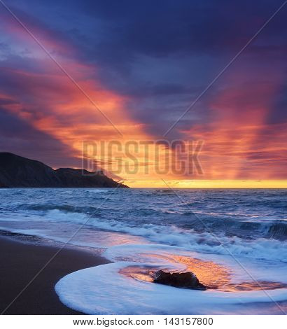Morning landscape with a beautiful sunrise. Seascape with waves