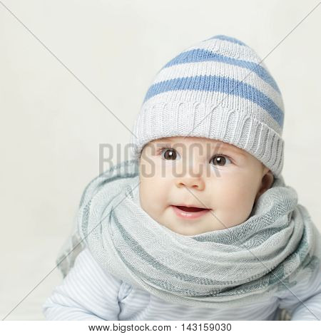 Little baby in blue hat and scarf