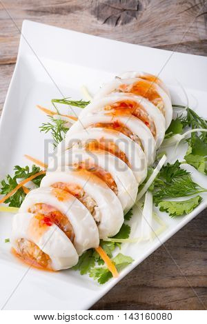 Steamed white squid stuffed with vegetables and sauce