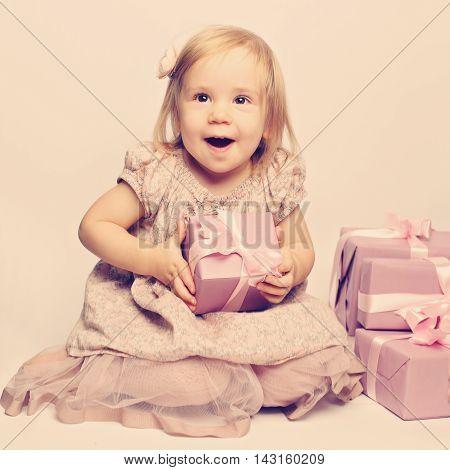 Happy beautiful joyfull baby and great gifts