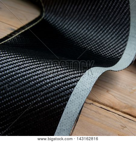 Black carbon fiber composite raw material background