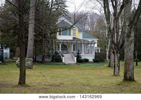 WEQUETONSING, MICHIGAN / UNITED STATES - DECEMBER 22, 2015: The Keller Cottage on Pennsylvania Avenue in Wequetonsing.
