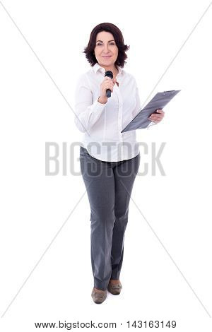 Full Length Portrait Of Mature Female Reporter With Microphone And Clipboard Isolated On White