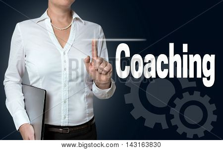 Coaching touchscreen is operated by businesswoman background