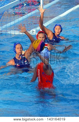 Budapest, Hungary - Jul 16, 2014. Hungarian team defending against VAN DER SLOOT Catharina (NED, 4). The Waterpolo European Championship was held in Alfred Hajos Swimming Centre in 2014.