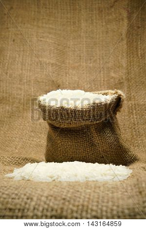 raw rice in sack bag raw material for cooking